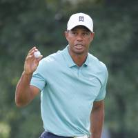Tiger three back after shooting 66