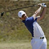 Defending champion McIlroy pulls out of British Open