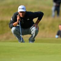 Johnson leads as strong winds create chaos at British Open