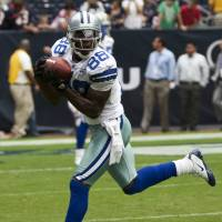 Star receiver Bryant threatens Cowboys with holdout