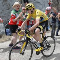 Froome all but locks up Tour after surviving '1,000 deaths'