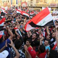 Thousands rally across Iraq behind al-Abadi's reforms; Anbar bloodshed continues
