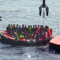 Packed trawler flips off Libya; 367 migrants rescued; 25 found dead