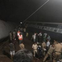 Two trains derail while crossing India bridge; rescuers search for casualties