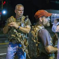Heavily armed 'Oath Keepers' inject new unease in riot-hit Ferguson