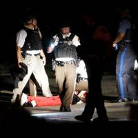Ferguson in state of emergency after gunfire mars protests; hospitalized shooter charged