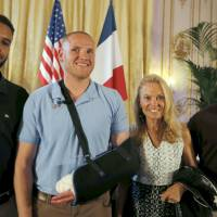 Train passengers who overpowered gunman get France's highest honor