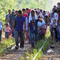 Hungary readies trains to ship record refugee arrivals at razor-wire border to camps