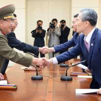 Koreas step back from brink; Pyongyang regrets blast; Seoul silences speakers