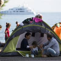 Ferry in Kos to house refugees as year's Mediterranean migrant crossings near 250,000
