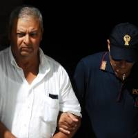 Italy nabs 11 in hunt for Sicilian Mafia don of dons on run since '93