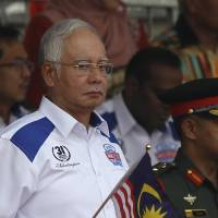 Defiant Malaysian PM affirms clout following weekend protests