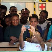 One-day record for migrant rescues in sea near Libya: 4,400