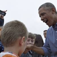 Obama sheds summer curse, just in time for daunting fall