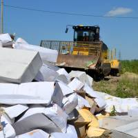 Stink erupts as Russia bulldozes smuggled cheese, fruit