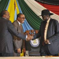 Facing sanctions, South Sudan leader reluctantly inks peace accord