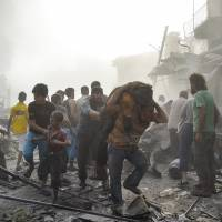 Syria army jet crashes while bombing rebel-held town; at least 31 dead: monitor