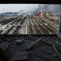 China arrests 12 over Tianjin blasts as toll rises