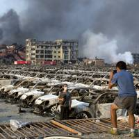 Death toll rises to 158 in blasts at China's Tianjin port