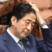 Abe defends internal documents on security bills