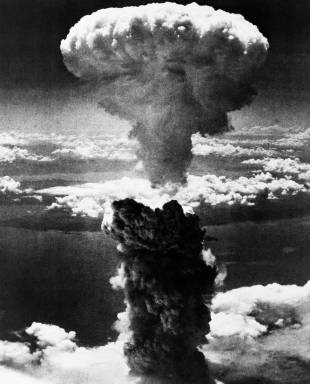 A mushroom cloud rises moments after an atomic bomb is dropped on Nagasaki on Aug. 9, 1945.