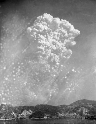 Smoke rises around 20,000 feet above Hiroshima after the first atomic bomb was dropped on Aug. 6, 1945.