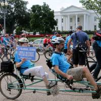 Cyclists pedal anti-nuclear message in Washington on Nagasaki A-bomb day