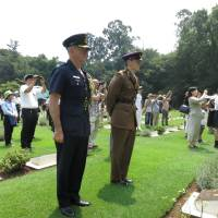 Tributes to WWII POWs paid during service at Yokohama cemetery