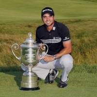 Day claims first major title