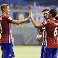 Atletico Madrid holds off Tosu on penalties