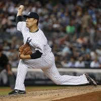 Tanaka beats Red Sox for eighth win