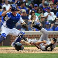Cubs sweep Giants; Aoki hit on head by pitch