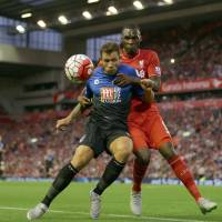 Liverpool sinks Bournemouth on Benteke's goal