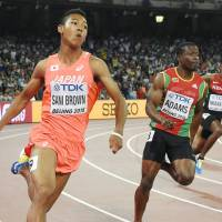 Fatigued Bolt, Gatlin sail into 200-meter semifinals; Sani Brown advances in worlds debut