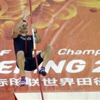 Pole vault champion Barber follows father's path to success