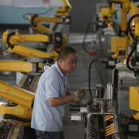 Robot revolution rises in China factories