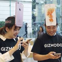 Apple puts two new iPhones on sale in Japan