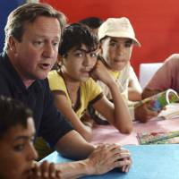 Cameron pledges aid during tour of Mideast camps hosting Syria refugees