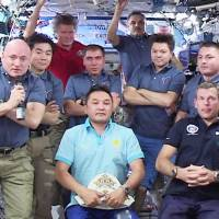 Russian cosmonaut back after setting record for amount of time spent in space