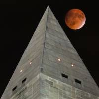 Skywatchers treated to unusual event as 'supermoon' puts on a show