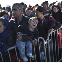 European ministers agree to relocate 120,000 refugees