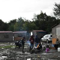 French camps run by armed smugglers keep migrants in fearful limbo