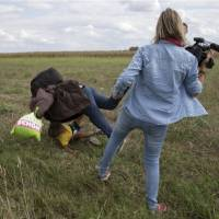 TV station of camerawoman who kicked migrants goes offline