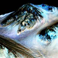 Sign of life? NASA sees liquid salty water rivulets on Mars in summer