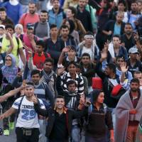 Migrants overwhelm Hungary's Serbia-border guards; Germany, France brace for influx