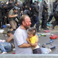 Chaos at Hungary border divides kids from families, Amnesty says