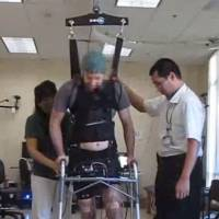 In a first, brain-computer link enables paralyzed man to walk