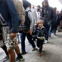 Hungary reopens westbound trains to refugees; 12,000 reach Austria