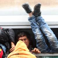 As leaders bicker, no train too full in desperate Europe sanctuary quest before cold sets in