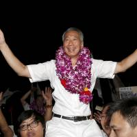Singapore's ruling party wins election by surprising margin